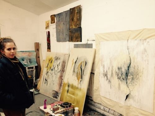 Katelynn Mills in her studio with some recent works.